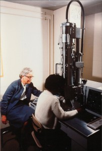 Professor Esther Carpenter and a Smith College student working on Smith's first Transmission Electron Microscope (TEM). Esther Carpenter was a zoology professor at Smith College from 1933 until her retirement in 1968. The TEM, a Philips, arrived at Smith College in 1966.
