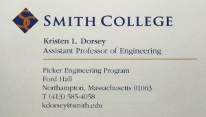 Photograph of business card and contact information. Phone: (413) 585-4058. Email KDorsey at Smith dot edu