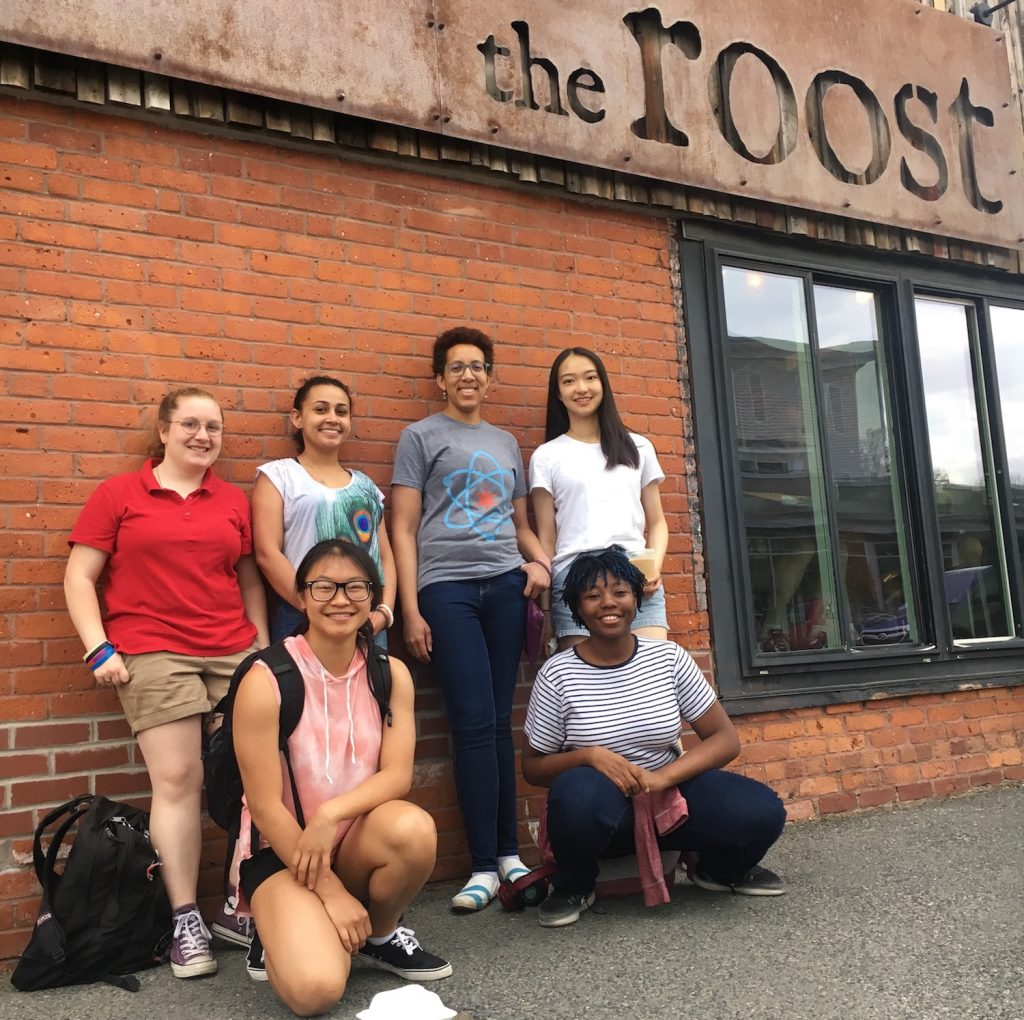 Photograph of students in the microsmithy lab, outside of a coffee shop.