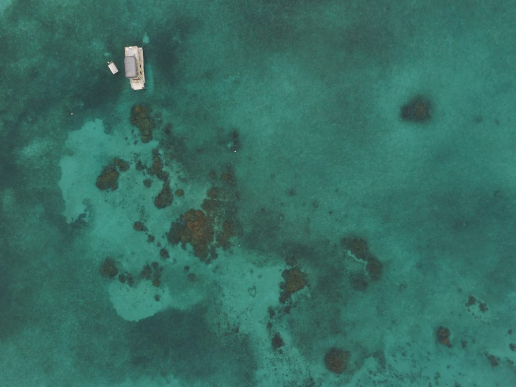 Several coral mounds in the Mexico Rocks area with a SNUBA boat (don't ask) in the upper left corner. Taken from the air with a drone.